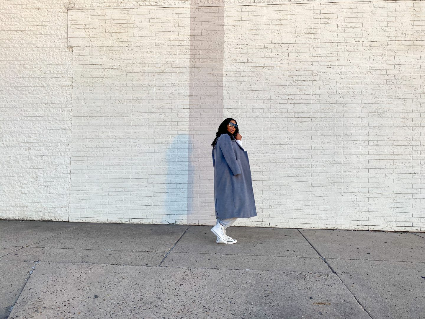 Black women wearing grey overcoat